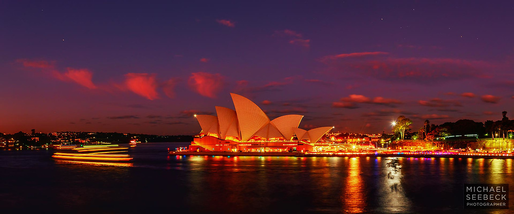 The Sydney Opera House with harbour ferries is captured at dusk in this high quality, high resolution photograph. Stars are visible toward the upper edges of the image.<br /> <br /> Code: CANM0001<br /> <br /> Limited Edition of 125 Prints