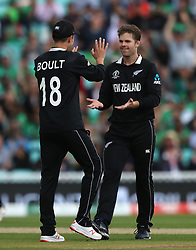 New Zealand's Lockie Ferguson celebrates taking the wicket of Bangladesh's Tamim Iqbal with team-mate Trent Boult during the ICC Cricket World Cup group stage match at The Oval, London.