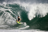 20 June 2006:  Body boarder JJ Ayala rides a Single set wave on one knee during a South swell reaches the famous surf spot in Newport Beach, CA called The Wedge.  Surfers, boogie boarders, body surfers and crowds gather to watch the powerful waves and the waters take shape into unique sets along the jetty in Orange County, California.