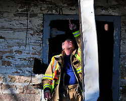 Hanover Township fire investigators asses the scene of a barn fire that started just after midnight Sunday Feb. 7th. 2016 in Hanover Township, Northampton County, Pa. Photo By | CHRIS POST