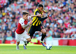 Watford's Etienne Capoue feels pressure from Arsenal's Lucas Torreira (left)
