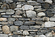 Close up of the wall of a restored traditional Hebridian blackhouse at Carloway on the Isle of Lewis, Outer Hebrides, Scotland on 18 July 2018. Blackhouses are the traditional crofting farmhouse of the Isle of Lewis, the double drystone walls, the low profile and the insulating thatch made the houses suitable for the Hebridean weather and all the building materials were natural and found locally