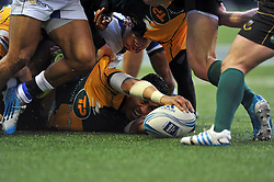George Pisi (Northampton) presents the ball after being tackled to ground - Photo mandatory by-line: Patrick Khachfe/JMP - Tel: Mobile: 07966 386802 23/05/2014 - SPORT - RUGBY UNION - Cardiff Arms Park, Cardiff - Bath Rugby v Northampton Saints - Amlin Challenge Cup Final.