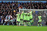 The Manchester city wall does its job as they block a free kick taken by Carles Gil (25) of Aston Villa. Barclays Premier league match, Aston Villa v Manchester city at Villa Park in Birmingham, Midlands  on Sunday 8th November 2015.<br /> pic by  Andrew Orchard, Andrew Orchard sports photography.