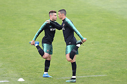 June 4, 2018 - Lisbon, Portugal - Portugal's forward Cristiano Ronaldo warms up with Portugal's defender Raphael Guerreiro during a training session at Cidade do Futebol (Football City) training camp in Oeiras, outskirts of Lisbon, on June 4, 2018, ahead of the FIFA World Cup Russia 2018 preparation match against Algeria. (Credit Image: © Pedro Fiuza/NurPhoto via ZUMA Press)