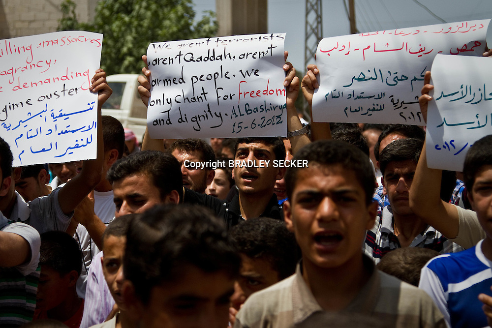 Demonstrators at an anti-government protest in Basheria, Idlib, Syria on Friday 15th June 2012. The weekly demonstrations call for the regime to step down and for democratic change. Basheria, Idlib, Syria. 15/06/2012