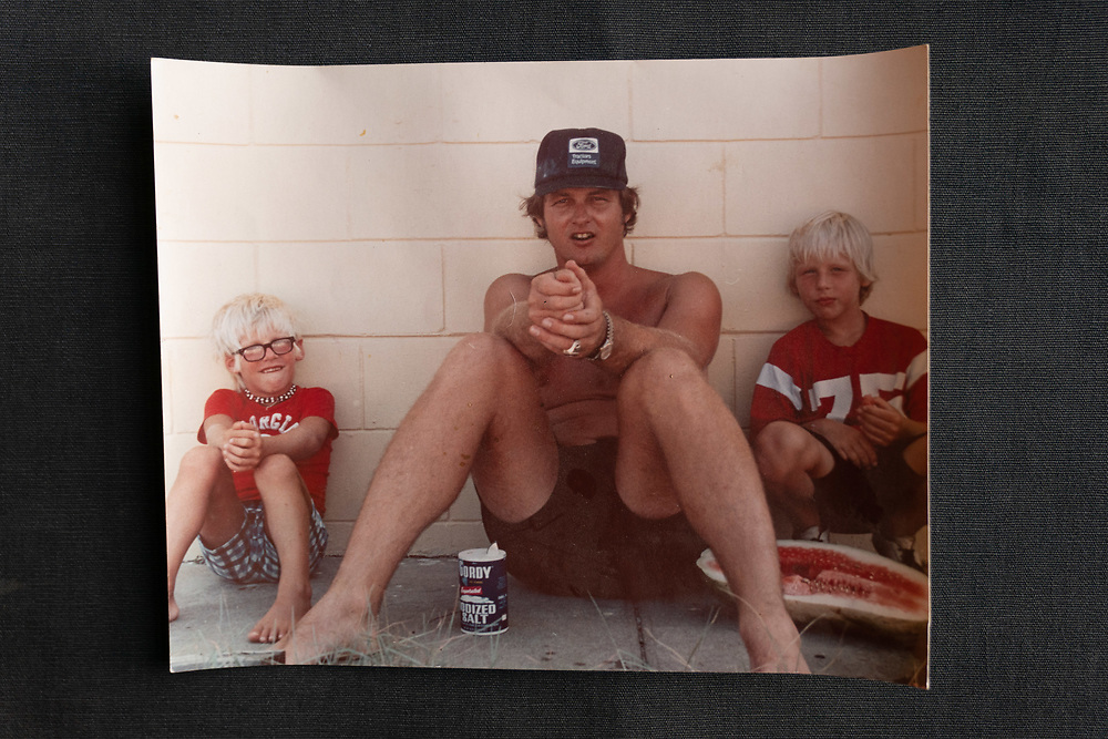 A family photo of Bill Stanfill showing his sons, Jake (left) and Stan Stanfill, how to shoot watermelon seeds with his hands. This photograph of a photo was taken at the home of his Stan Stanfill outside Athens, Ga on Wednesday, January 22, 2020. <br /> <br /> Bill Stanfill's children are going public with the fact that he suffered from CTE. Bill Stanfill played several years for the Miami Dolphins, including their famed 1972 season in which they went undefeated and won Super Bowl VII. Photo by Kevin D. Liles for The New York Times