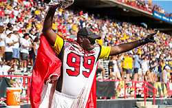 Sep 4, 2021; College Park, Maryland, USA; A Maryland Terrapins fan cheers during the first quarter against the West Virginia Mountaineers at Capital One Field at Maryland Stadium. Mandatory Credit: Ben Queen-USA TODAY Sports