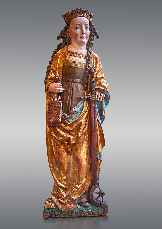 Painted Gothic gilded wooden statue altarpiece of Saint Catherine, circa 1520-1525 by Niklaus Weckmann from Ulm, Germany. The young Christian martyr is represented with his usual attributes, crown, book, wheel, sword, which make reference to her legendary life and her martyrdom. The bas-relief of Saint Catherine was originally part of an altarpiece. The treatment  and refined painted facial highlights executed the prettiness of the saint. The style is typical of  Niklaus Weckmann, one great masters of late Gothic Swabian art . Inv RF 2207.6,  The Louvre Museum, Paris. .<br /> <br /> If you prefer you can also buy from our ALAMY PHOTO LIBRARY  Collection visit : https://www.alamy.com/portfolio/paul-williams-funkystock/gothic-art-antiquities.html  Type -   louvre     - into the LOWER SEARCH WITHIN GALLERY box. Refine search by adding background colour, place, museum etc<br /> <br /> Visit our MEDIEVAL ART PHOTO COLLECTIONS for more   photos  to download or buy as prints https://funkystock.photoshelter.com/gallery-collection/Medieval-Gothic-Art-Antiquities-Historic-Sites-Pictures-Images-of/C0000gZ8POl_DCqE