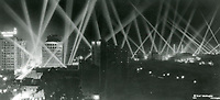 1929 Searchlights pierce the night sky in Hollywood