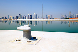 View across The Creek towards skyline of Dubai and Burj Khalifa at Business Bay in United Arab Emirates