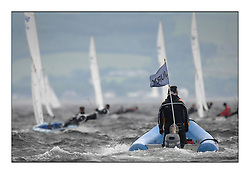 470 Class European Championships Largs - Day 1.Racing in grey and variable conditions on the Clyde..Jury Boat