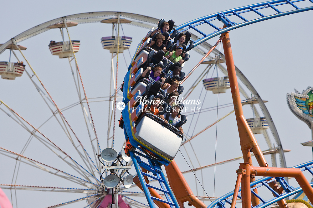 People ride a rollercoaster at the Oklahoma State Fair in Oklahoma City, OK. on Monday, Sept. 20, 2010.  (Photo by Alonzo J. Adams)