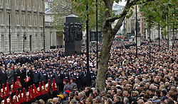 (c) London News Pictures. 14/11/2010.  Large crowds await the start of Remembrance Sunday service at the Cenotaph. The Queen today (Sun) led the Remembrance Sunday service at the Cenotaph in London in honour of those who have died in wars and conflicts. Picture credit should read: Will Oliver/London News Pictures