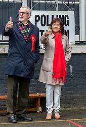 © Licensed to London News Pictures. 12/12/2019. London, UK. Jeremy Corbyn Leader of the Labour Party with his wife Laura arrives at the polling Station in Islington to cast his vote in today's General Election as the Country decides on a new political party and Prime Minister. Photo credit: Alex Lentati/LNP