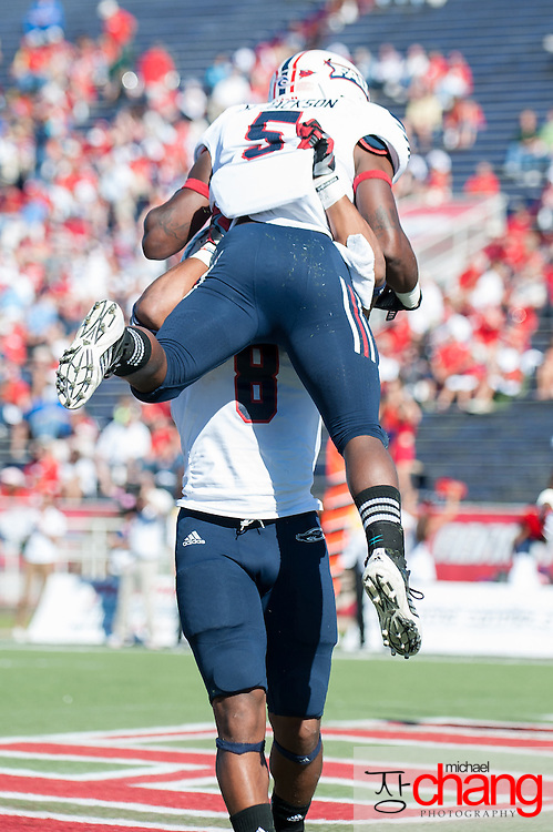 MOBILE, AL - OCTOBER 20:  Running back Martese Jackson #5 of the Florida Atlantic Owls celebrates with wide receiver Daniel McKinney #8 of the Florida Atlantic Owls after scoring a touchdown while playing against the South Alabama Jaguars on October 20, 2012 at Ladd-Peebles Stadium in Mobile, Alabama. South Alabama defeated Florida Atlantic in the second overtime 37-34.  (Photo by Michael Chang/Getty Images) *** Local Caption *** Martese Jackson;Daniel McKinney