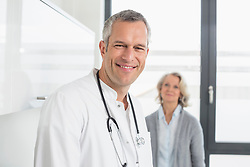 Doctor and patient, smiling