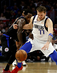 February 25, 2019 - Los Angeles, California, U.S - Los Angeles Clippers' Patrick Beverley (21) and Dallas Mavericks' Luka Doncic (77) battle for a ball during an NBA basketball game between Los Angeles Clippers and Dallas Mavericks Monday, Feb. 25, 2019, in Los Angeles. (Credit Image: © Ringo Chiu/ZUMA Wire)