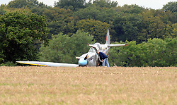 © Licensed to London News Pictures. 07/09/2015<br /> Spitfire plane had to make an emergency landing this morning (07.09.2015) in a field in Woodchurch,Kent.<br /> <br /> <br /> (Byline:Grant Falvey/LNP)