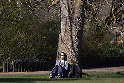 © Licensed to London News Pictures. 30/03/2021. London, UK. A woman relaxes in a sunny Greenwich Park in South East London. Temperatures are expected to rise with highs of 23 degrees forecasted for parts of London and South East England today . Photo credit: George Cracknell Wright/LNP