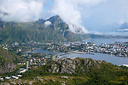 View from Tjeldbergtind 367m of the town Svolvaer on 21st August 2016, Lofoten Islands, Norway. The Lofoten islands are famous for their jagged mountains, red-painted rorbu cabins and racks with fish hanging closely packed to dry.