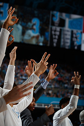 CHAPEL HILL, NC - FEBRUARY 05: North Carolina Tar Heels bench holds up three fingers to signify a three-point shot made during a game against the North Carolina State Wolfpack on February 05, 2019 at the Dean Smith Center in Chapel Hill, North Carolina. North Carolina won 113-96. North Carolina wore retro uniforms to honor the 50th anniversary of the 1967-69 team. (Photo by Peyton Williams/UNC/Getty Images)