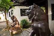 Iron lion statues guard the entry to Yu Yuan Gardens Shanghai, China