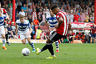 Brentford Forward Ollie Watkins (11) takes a penalty and fails to score during the EFL Sky Bet Championship match between Brentford and Queens Park Rangers at Griffin Park, London, England on 21 April 2018. Picture by Andy Walter.