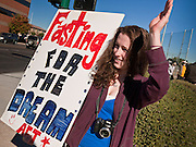 """07 DECEMBER 2010 - PHOENIX, AZ:  JULIE CAMERON from Chandler, AZ, pickets the offices of US Sen. John McCain in Phoenix Tuesday. Dolores Huerta, who started working in the civil rights movement in the 1960's, threw her support behind students fasting on behalf of the DREAM Act in front of Sen. John McCain's office Tuesday. The student picked McCain's office because he used to support the DREAM Act. They hope that the US Senate will pass the DREAM Act during its """"lame duck"""" session. The Senate debated and defeated similar legislation just before the November general election.   PHOTO BY JACK KURTZ"""