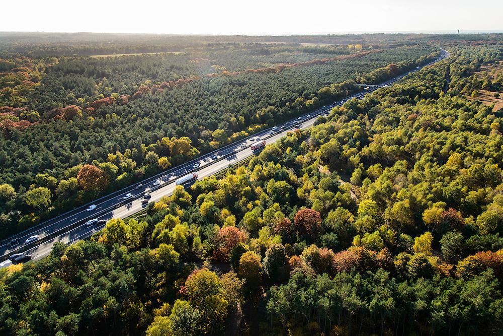 Nederland, Gelderland, Ede, 24-10-2013. Avondspits begint in de namiddag op autosnelweg A12 tussen Ede en Arnhem en doorkruist de bossen in herfstkleuren van de Veluwe.<br /> Traffic in autumn in central Netherlands, on motorway A12 between woods of nature area De Veluwe.<br /> luchtfoto (toeslag op standaard tarieven);<br /> aerial photo (additional fee required);<br /> copyright foto/photo Siebe Swart.