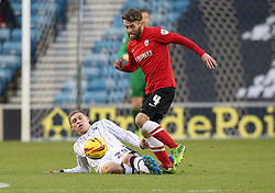 Millwall's Martyn Waghorn tackles Barnsley's Thomas Kennedy - Photo mandatory by-line: Robin White/JMP - Tel: Mobile: 07966 386802 23/11/2013 - SPORT - Football - Millwall - The Den - Millwall v Barnsley - Sky Bet Championship
