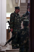 Members of the Armenian armed forces are seen carrying AK 47 rifle within the Ministry of Finance premises in Capital Yerevan on Tuesday, Dec 15 2020 - meanwhile protestors were marching outside the ministry demanding the resignation of Armenia's Prime Minister Nikol Pashinyan and calling him a traitor. Capital Yerevan has seen on-going protests since the November 9 ceasefire that was signed in Nagorno-Karabakh between Armenia, Russia, and Azerbaijan, an agreement that came into effect and resulted with Armenian troops withdrawal from the troubled region. (VXP Photo/ Vudi Xhymshiti)