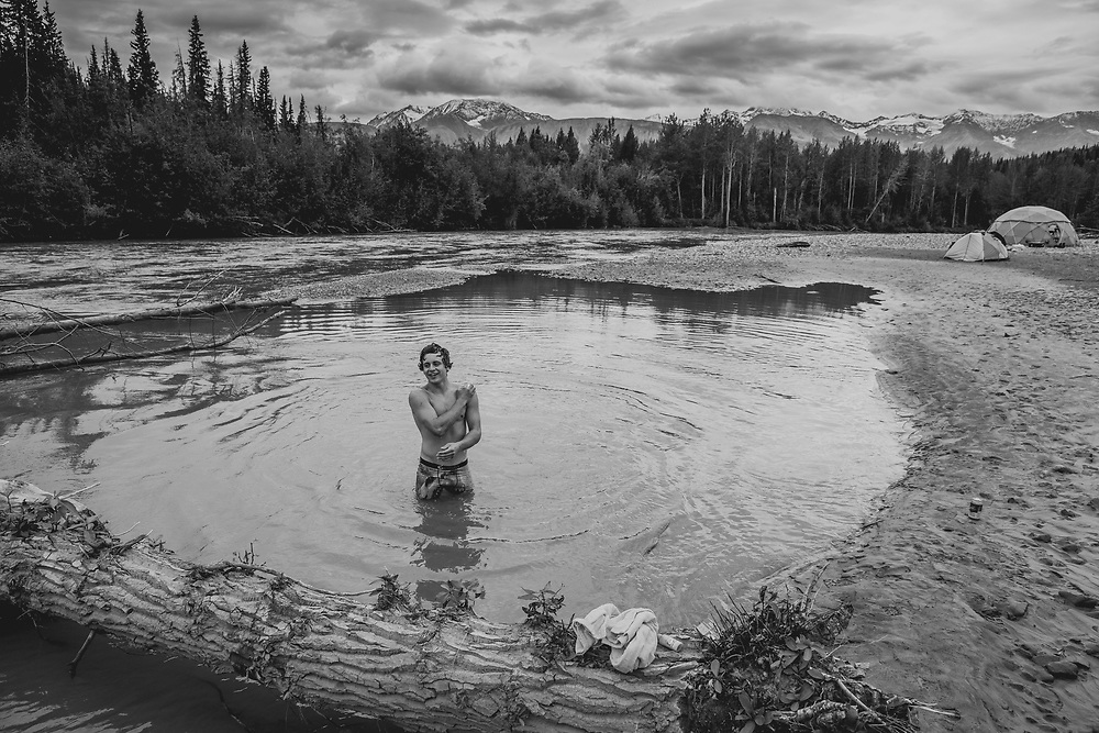Carson Storch bathes at camp in the Tatshenshini-Alsek Provincial Park in British Columbia, Canada on September 1, 2016.