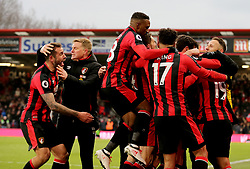AFC Bournemouth players celebrate after AFC Bournemouth's Junior Stanislas (obscured) scores his side's second goal of the game during the Premier League match at the Vitality Stadium, Bournemouth.