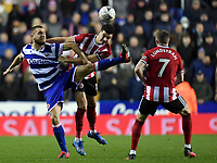 Football - 2019 / 2020 Emirates FA Cup - Fifth Round: Reading vs. Sheffield United<br /> <br /> Reading's George Puscas battles for possession with Sheffield United's John Egan, at the Madejski Stadium.<br /> <br /> COLORSPORT/ASHLEY WESTERN