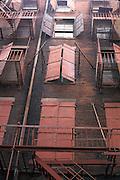 Vertical view of windows with rusty metal doors