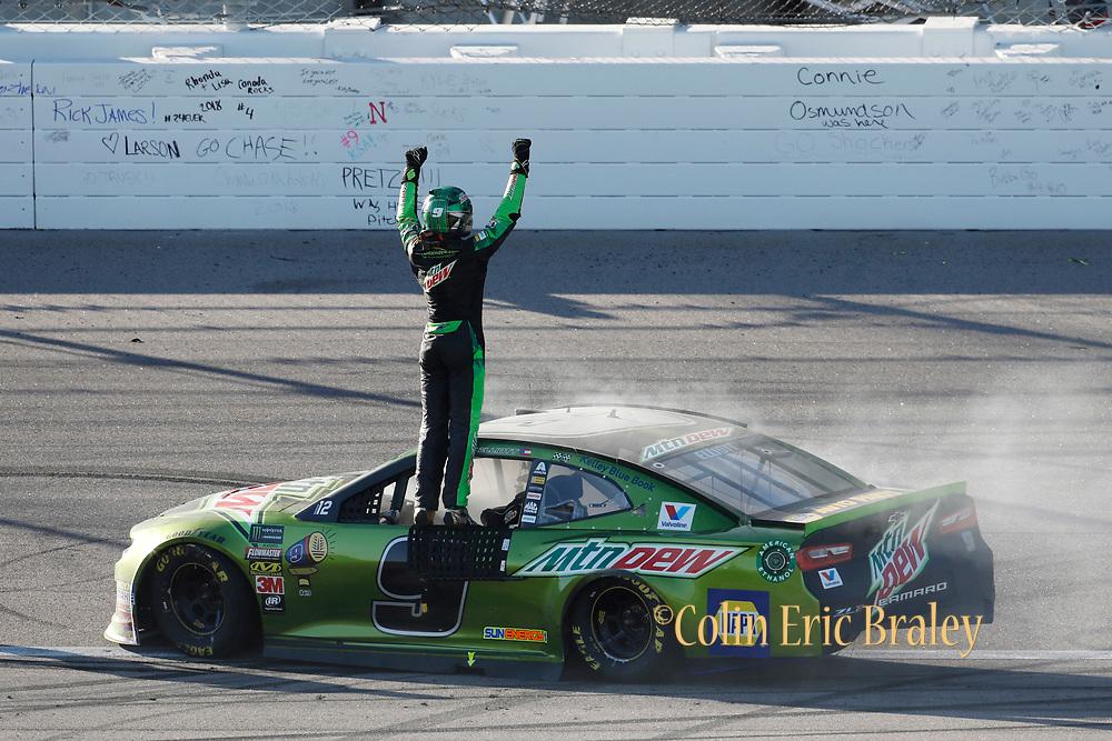 Chase Elliott celebrates winning a NASCAR Cup Series auto race at Kansas Speedway in Kansas City, Kan., Sunday, Oct 21, 2018. (AP Photo/Colin E. Braley)