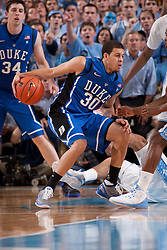 CHAPEL HILL, NC - MARCH 05: Seth Curry #30 of the Duke Blue Devils dribbles the ball while playing the North Carolina Tar Heels on March 05, 2011 at the Dean E. Smith Center in Chapel Hill, North Carolina. North Carolina won 67-81. (Photo by Peyton Williams/UNC/Getty Images) *** Local Caption *** Seth Curry
