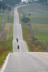 Licenced Harley-Davidson artist Scott Jacobs with Sharon Jacobs and Cris Simmons ride up and down the rolling hills during stage 6 of the Motorcycle Cannonball Cross-Country Endurance Run, which on this day ran from Cape Girardeau to Sedalia, MO., USA. Wednesday, September 10, 2014.  Photography ©2014 Michael Lichter.
