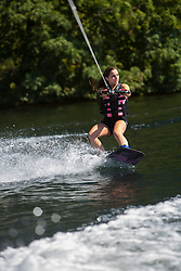 United States, Washington, Lake Sawyer, teen girl doing a wakeboarding jump.  MR