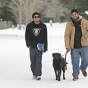 Julian Ortiz, left, and Noel Ortiz walk down Winston Blvd. in Wilmington, N.C. Wednesday January 29, 2014. Wilmington saw a wintry mix of sleet, snow, and freezing rain Tuesday and Wednesday which caused extensive closings throughout the area. (Jason A. Frizzelle)