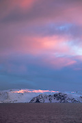Scenic view of snow-capped mountain against cloudy sky at sunrise, Havoysund, Norway