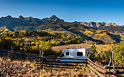 Mt Sneffels rises above yellow fall aspen colors and our Pleasure-Way RV along Ouray County Road 5, in Uncompahgre National Forest, Ridgway, Colorado, USA. This image was stitched from multiple overlapping photos.