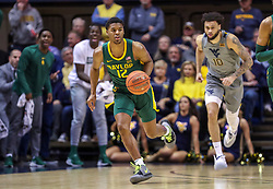 Mar 7, 2020; Morgantown, West Virginia, USA; Baylor Bears guard Jared Butler (12) dribbles up the floor during the first half against the West Virginia Mountaineers at WVU Coliseum. Mandatory Credit: Ben Queen-USA TODAY Sports
