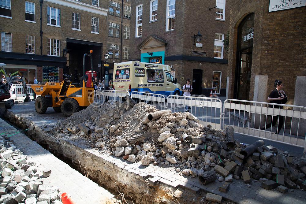 Ground works underway in Covent Garden in London, England, United Kingdom.