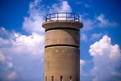 Cumulus clouds gather behind a World War II-era observation tower on the beach at Cape Henlopen State Park in Rehoboth Beach, Del., Monday, Aug. 19, 2019. (Photo by D. Ross Cameron)