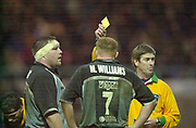 Photo Peter Spurrier<br /> 07/12/2002<br /> European Rugby - Heineken Cup Northamton vs Cardiff.<br /> Cardiff Coach David Young left, receives the yellow card from referee Iain Ramage as Captian Maryten Williams look's on.