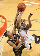 Jan. 27, 2011; Charlottesville, VA, USA; Virginia Cavaliers guard Jontel Evans (1) shoots over Maryland Terrapins guard Terrell Stoglin (12) during the game at the John Paul Jones Arena. Maryland won 66-42. Mandatory Credit: Andrew Shurtleff