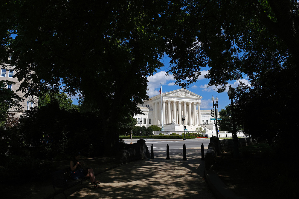 WASHINGTON - JUNE 30, 2019: The Supreme Court of the United States is seen through trees June 30, 2019, in Washington, D.C.