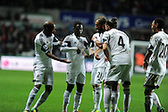 Swansea city's Nathan Dyer (c) celebrates with a dance with his teammates after he scores the 1st goal. Barclays Premier League match, Swansea city v Newcastle Utd at the Liberty stadium in Swansea, South Wales on Wednesday 4th Dec 2013. pic by Andrew Orchard, Andrew Orchard sports photography,